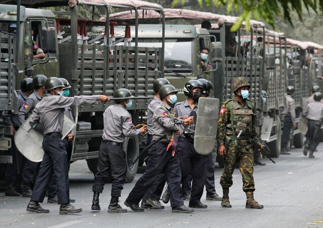 Police and soldiers are seen during a protests against the military coup, in Mandalay, Myanmar, February 20, 2021