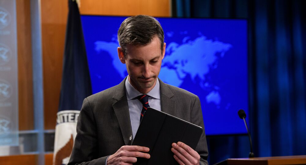 U.S. State Department spokesman Ned Price leaves after the during daily press briefing at the State Department in Washington, DC, U.S., February 22, 2021