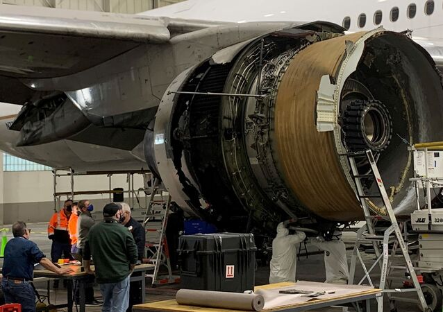 The damaged starboard engine of United Airlines flight 328, a Boeing 777-200, is seen following a February 20 engine failure incident