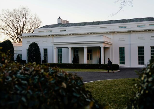 The West Wing of the White House is seen at sunrise during US President Joe Biden's first week in office in Washington, 24 January 2021