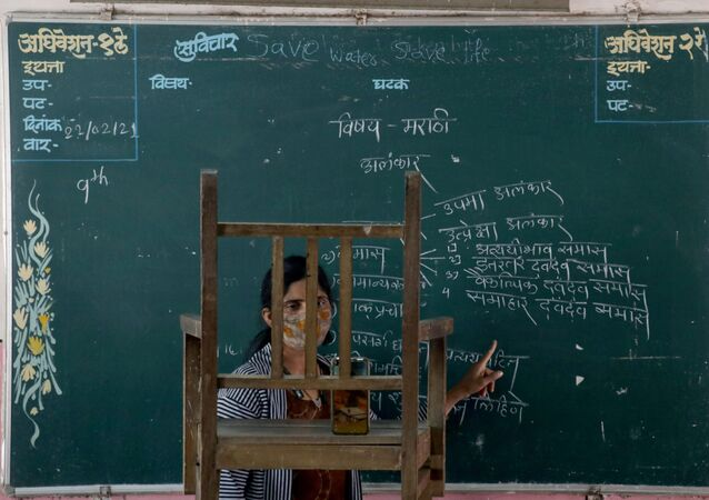 A teacher conducts an online class for her students inside a government-run school, amidst the spread of the coronavirus disease (COVID-19), in Mumbai, India, February 22, 2021.