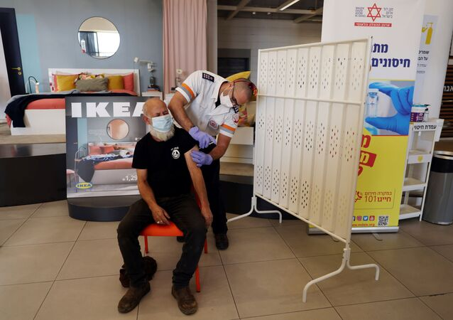 A man receives a vaccination against the coronavirus disease (COVID-19) in an IKEA store in Rishon Lezion, Israel February 22, 2021.