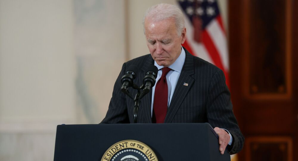 US President Joe Biden concludes his remarks in honor of the 500,000 US deaths from the coronavirus disease (COVID-19), in the Cross Hall at the White House in Washington, U.S., February 22, 2021