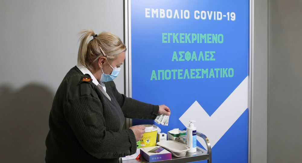 A Greek Army medical personnel member works inside a vaccination booth during a media tour at a vaccination centre, amid the coronavirus disease (COVID-19) pandemic, in Athens, Greece, February 13, 2021.