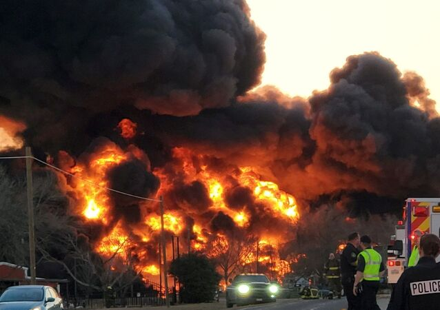 A fire is seen at the place of the train and truck collision in Cameron, Texas, U.S., February 23, 2021, in this still image obtained from a social media video.