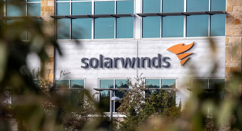 FILE PHOTO: The SolarWinds logo is seen outside its headquarters in Austin, Texas, U.S., December 18, 2020.