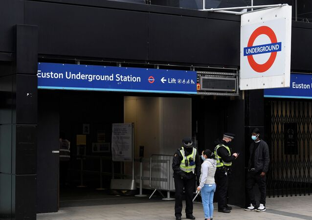British Transport Police officers check on travellers as they arrive at Euston rail station during lockdown restrictions, amid the spread of the coronavirus disease (COVID-19) pandemic, London, Britain, January 31, 2021.