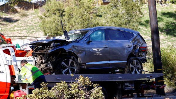 The damaged car of Tiger Woods is towed away after he was involved in a car crash, near Los Angeles, California, 23 February 2021.  - Sputnik International