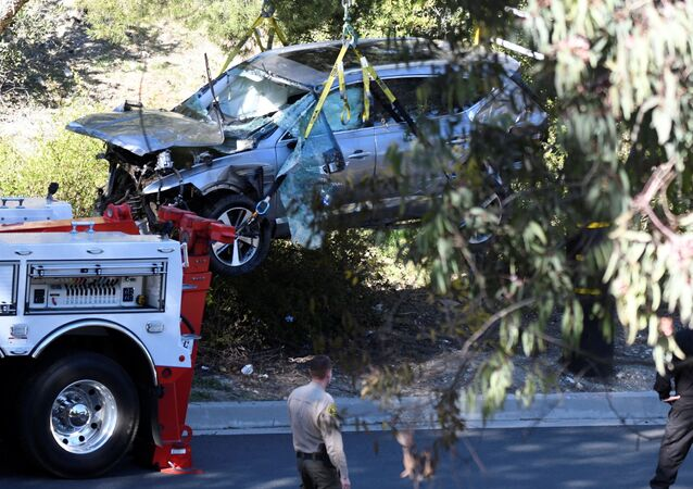 The vehicle of golf legend Tiger Woods, who was rushed to hospital after suffering multiple injuries, is lifted by a crane after being involved in a single-vehicle accident in Los Angeles, California, US, 23 February 2021.