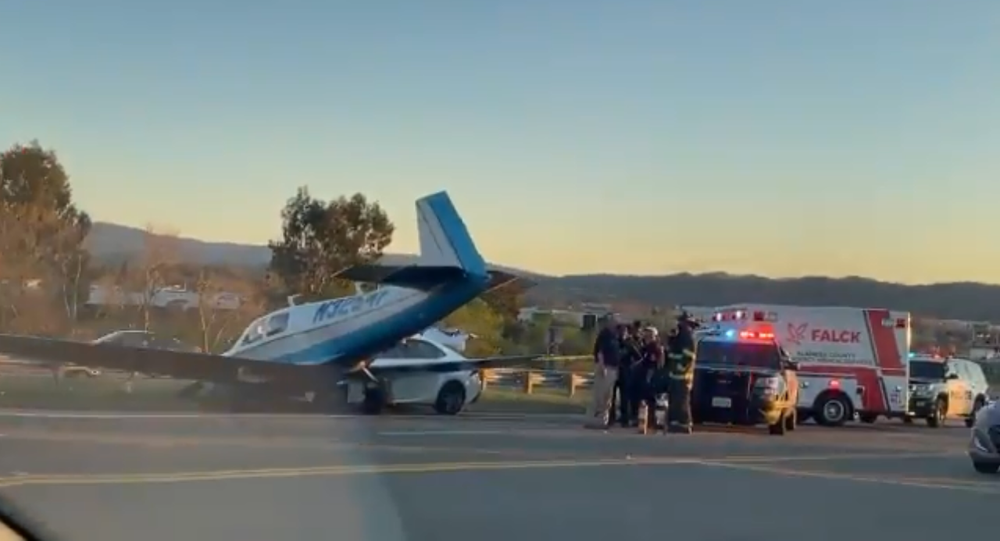 Screenshot of a video showing the aftermath of a small plane crashing into a car on an interstate in Livermore, California, 23 February 2020
