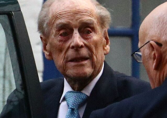 Britain's Prince Philip enters a car as he leaves King Edward VII's Hospital in London, Britain, 24 December 2019