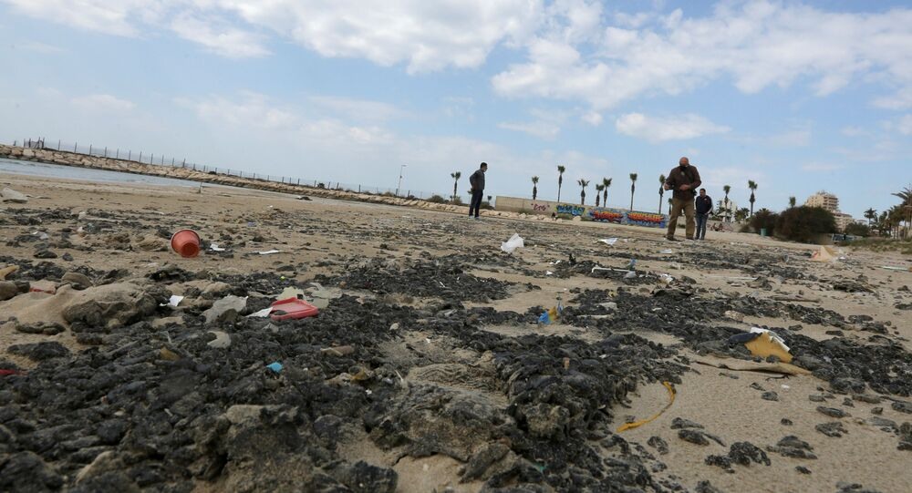 Tar is seen on the beach in the aftermath of an oil spill that drenched much of the Mediterranean, in Tyre nature reserve, Lebanon February 22, 2021