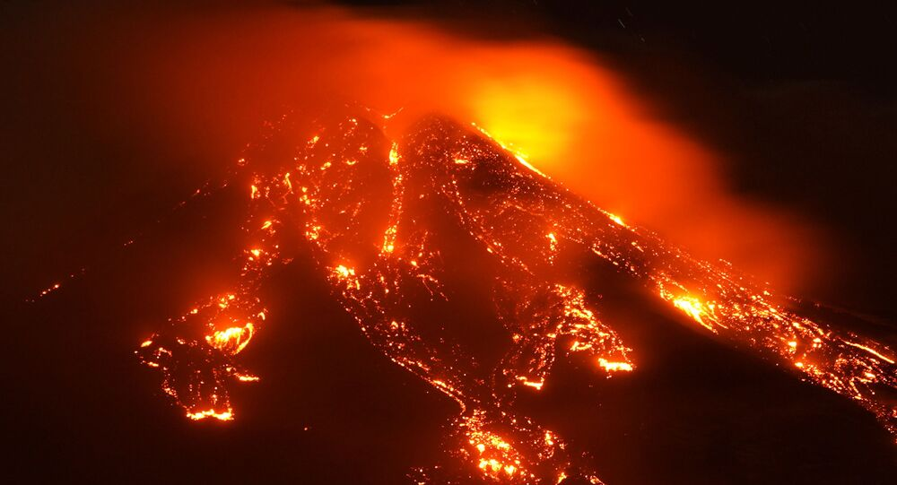 Streams of red hot lava flow as Mount Etna, Europe's most active volcano, erupts, seen from Giarre, Italy, February 16, 2021.