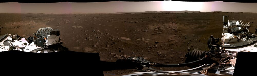 A panoramic photo of the Martian landscape, made up of individual images taken by the Navigation Cameras, or Navcams, aboard NASA's Perseverance Mars rover.
