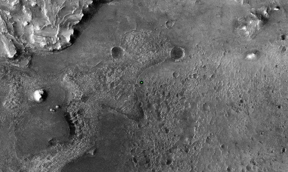 A green dot marks where NASA's Perseverance Mars rover landed in Jezero Crater on Mars, 18 February 2021, in a base image taken by the HiRISE camera aboard NASA's Mars Reconnaissance Orbiter.