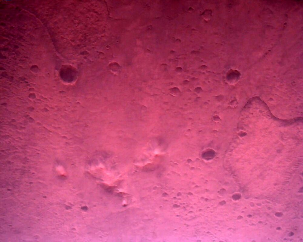 The Martian craters spotted on the planet's surface. The image taken by the Rover Down-Look Camera on 22 February 2021.