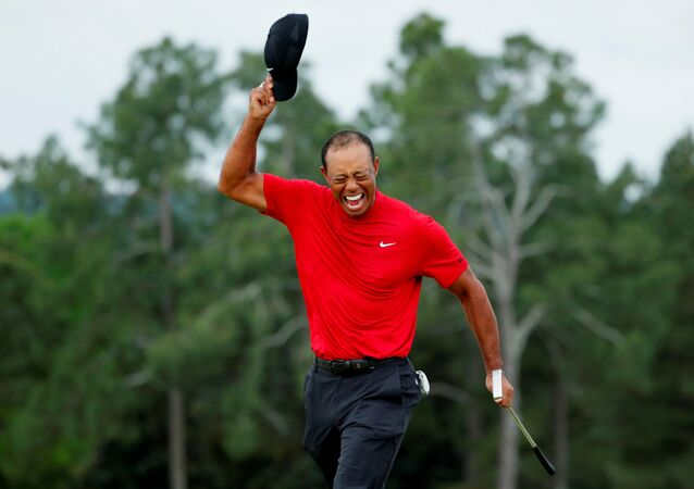 FILE PHOTO: Golf - Masters - Augusta National Golf Club - Augusta, Georgia, U.S. - April 14, 2019 - Tiger Woods of the U.S. celebrates on the 18th hole after winning the 2019 Masters. REUTERS/Brian Snyder/File Photo