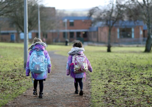 Pupils walk to Pitlochry High School on the first day back following the easing of the coronavirus disease (COVID-19) restrictions, in Pitlochry, Scotland, Britain, February 22, 2021