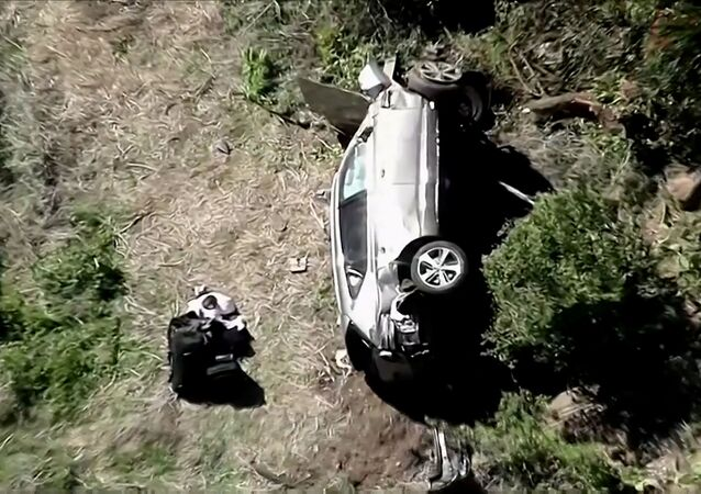 The vehicle of golfer Tiger Woods, who was rushed to hospital after suffering multiple injuries, lies on its side after being involved in a single-vehicle accident in Los Angeles, California, U.S. in a still image from video taken February 23, 2021