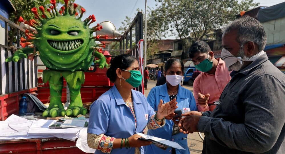 Volunteers distribute pamphlets during an awareness campaign on the spread of the coronavirus disease (COVID-19) on a street in Mumbai, India, February 22, 2021