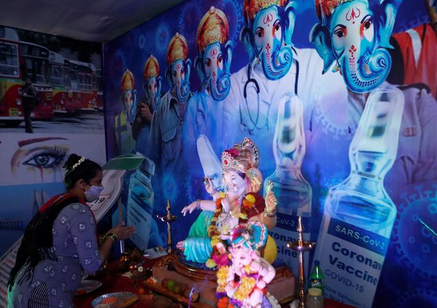 A devotee prays to the Hindu god Ganesh, the deity of prosperity, on the occasion of his birthday, celebrated as Magha Ganesh Jayanti, at a coronavirus disease (COVID-19) themed pandal in Mumbai, India February 16, 2021