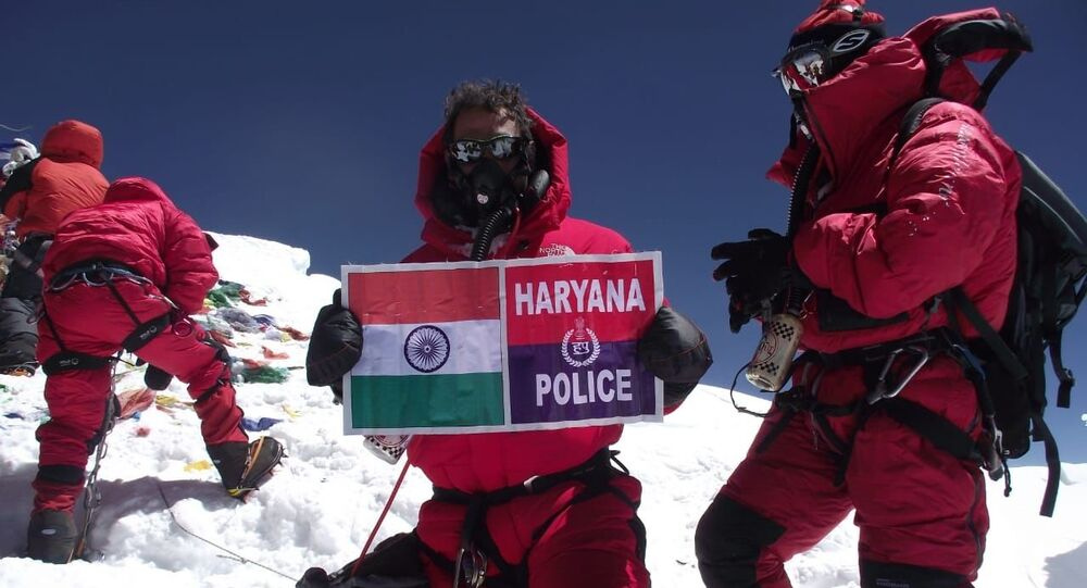 Kapil Ruhil atop Mt Everest with Indian Flag