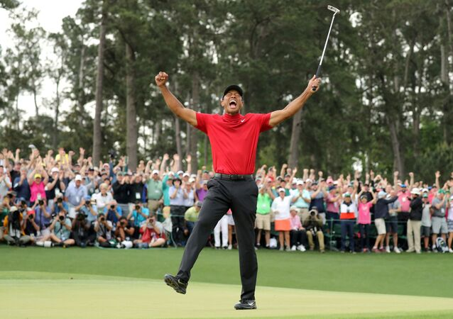 FILE PHOTO: Golf - Masters - Augusta National Golf Club - Augusta, Georgia, U.S. - April 14, 2019. Tiger Woods of the U.S. celebrates on the 18th hole to win the 2019 Masters.