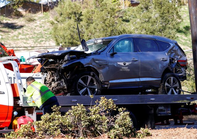 The damaged car of Tiger Woods is towed away after he was involved in a car crash, near Los Angeles, California, U.S., February 23, 2021. REUTERS/Mario Anzuoni