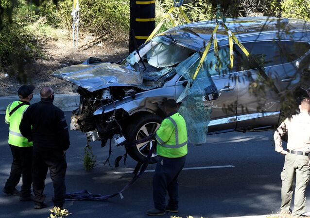 The vehicle of golfer Tiger Woods, who was rushed to hospital after suffering multiple injuries, is lifted by a crane after being involved in a single-vehicle accident in Los Angeles, California, U.S. February 23, 2021.