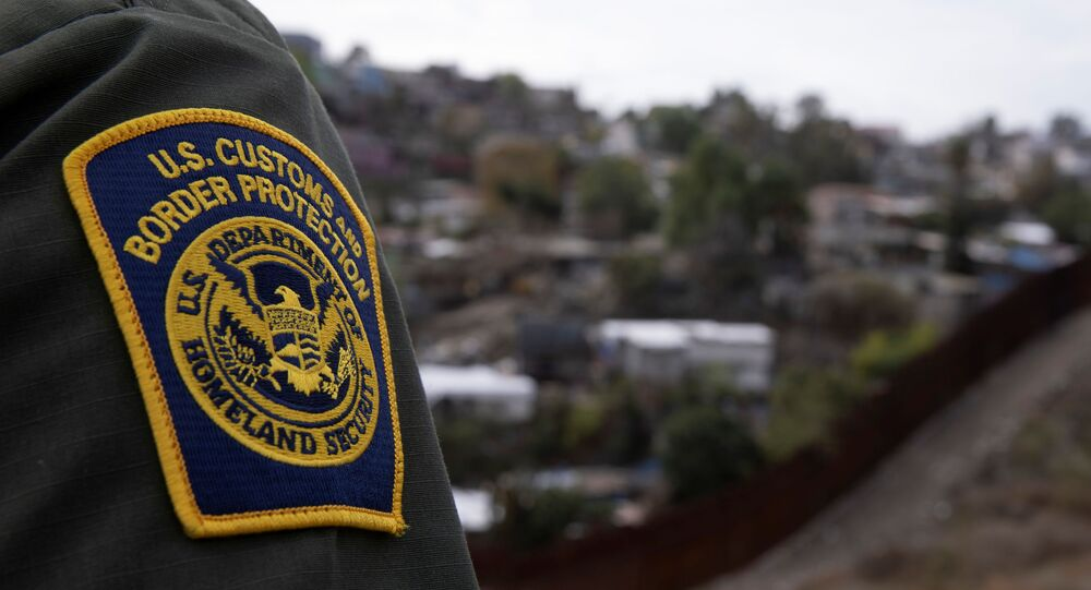 A US border patrol agent looks out over Tijuana, Mexico from the border wall in San Diego, California, US, 2 February 2021.