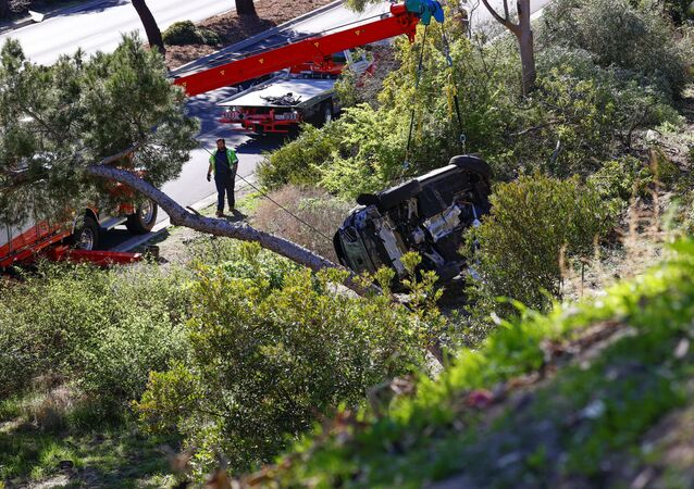 The overturned car of Tiger Woods is seen after he was involved in a car crash, near Los Angeles, California, U.S., February 23, 2021.