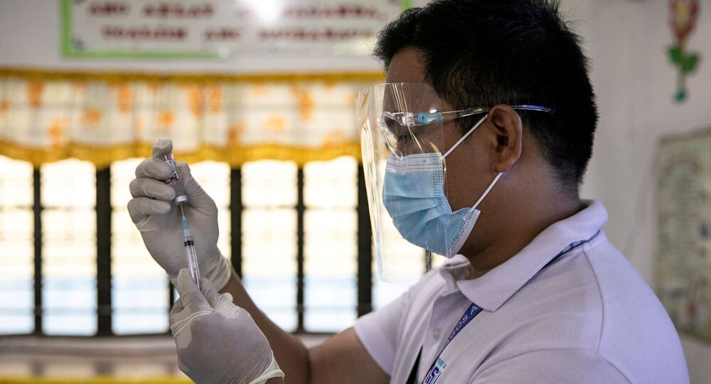 A health worker participates in a simulation for COVID-19 vaccination in preparation for its arrival, at an elementary school turned vaccination command center in Pasig City, Metro Manila, Philippines, February 16, 2021