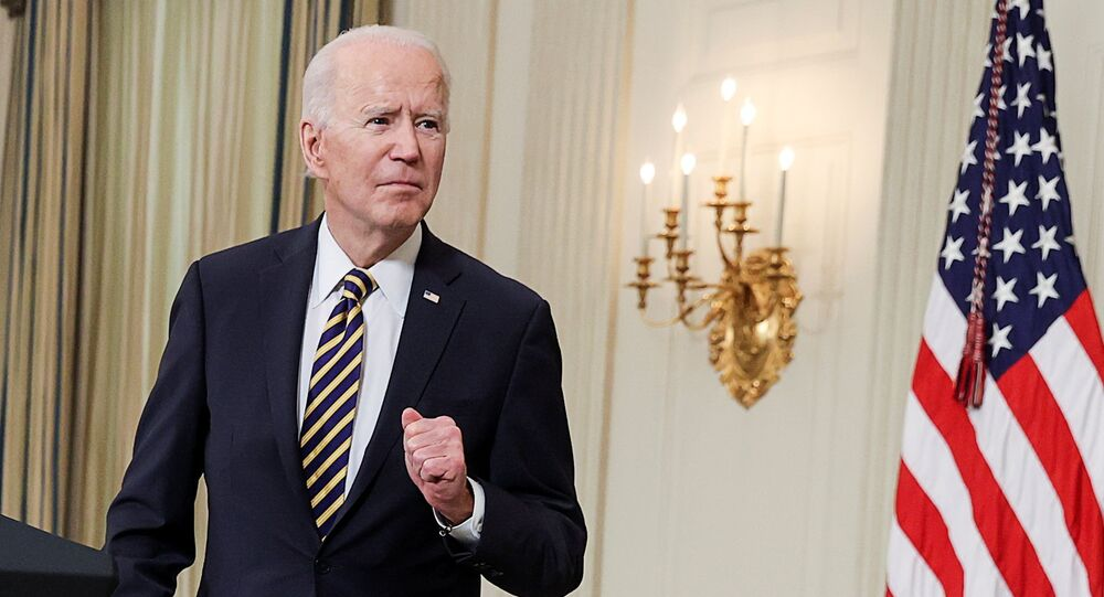 U.S. President Joe Biden listens to a question after delivering remarks and prior to signing an executive order, aimed at addressing a global semiconductor chip shortage, in the State Dining Room at the White House in Washington, U.S., February 24, 2021