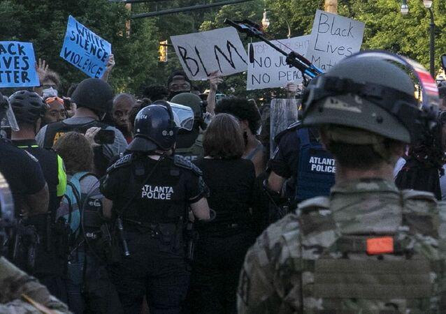 Georgia National Guard Soldiers and Airmen support Atlanta Police Department officers enforcing curfew in Atlanta June 1, 2020