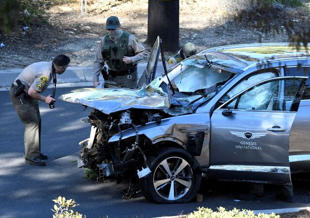 Los Angeles County Sheriff's Deputies inspect the SUV of golfer Tiger Woods, who was rushed to hospital after suffering a number of injuries as the result of a single-vehicle accident in Los Angeles, California, US, 23 February 2021.