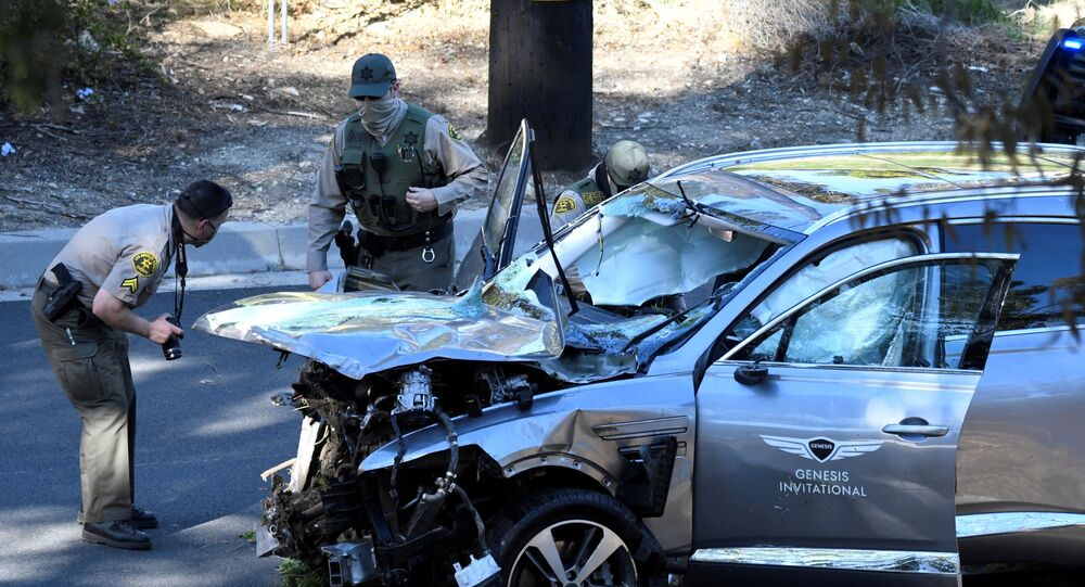 Los Angeles County Sheriff's Deputies inspect the vehicle of golfer Tiger Woods, who was rushed to hospital after suffering multiple injuries, after it was involved in a single-vehicle accident in Los Angeles, California, U.S. February 23, 2021