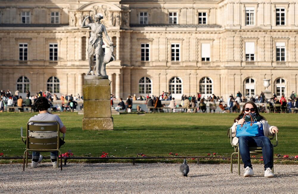 People, wearing protective face masks, enjoy a sunny and warm weather at the Luxembourg Gardens in Paris amid the coronavirus disease (COVID-19) outbreak in France, 24 February 2021.