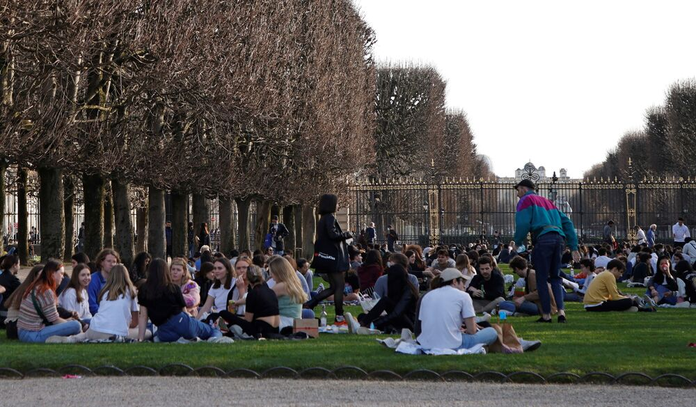 People enjoy a sunny and warm weather at the Luxembourg Gardens in Paris amid the coronavirus disease (COVID-19) outbreak in France, 24 February 2021.