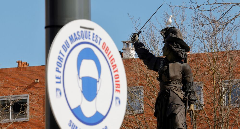 A placard which reads Wearing a mask is mandatory is seen near the Jean Bart statue in Dunkirk as the government eyes new measures to limit the spread of coronavirus disease (COVID-19) in the region, France, February 24, 2021