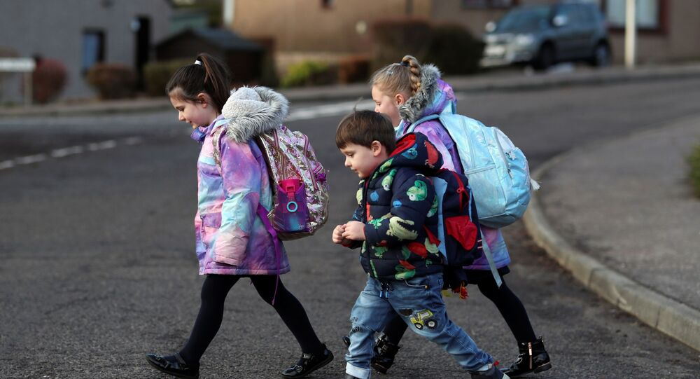 Pupils walk to Pitlochry High School on the first day back following the easing of the coronavirus disease (COVID-19) restrictions, in Pitlochry, Scotland, Britain, February 22, 2021.
