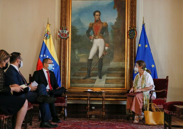 Venezuela's Foreign Minister Jorge Arreaza talks to the ambassador of the European Union to Venezuela, Isabel Brilhante Pedrosa, during a meeting at the Foreign Ministry headquarters in Caracas, Venezuela February 24, 2021.