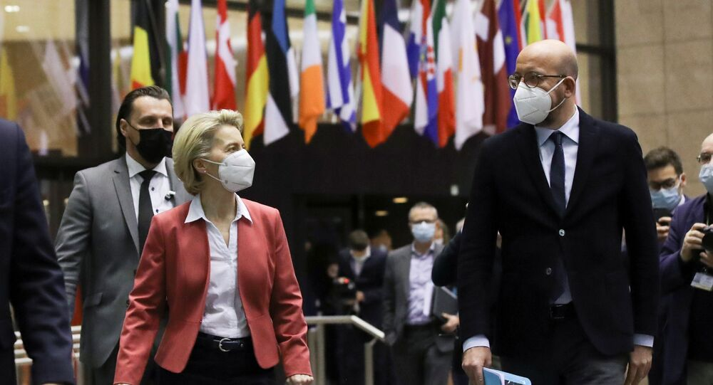 European Commission President Ursula von der Leyen and European Council President Charles Michel prepare for a press conference at the end of a video conference of European Council members on COVID-19 pandemic, in Brussels, Belgium February 25, 2021