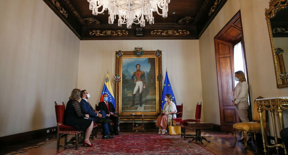 Venezuela's Foreign Minister Jorge Arreaza talks to the ambassador of the European Union to Venezuela, Isabel Brilhante Pedrosa, during a meeting at the Foreign Ministry headquarters in Caracas, Venezuela February 24, 2021