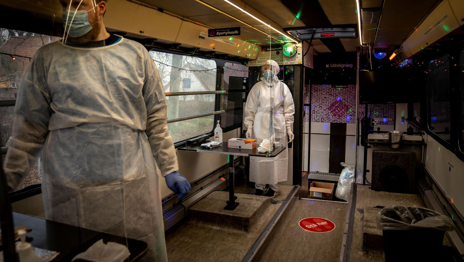 Healthcare workers wait in the Partybus, where people can listen to music while being tested for the coronavirus disease (COVID-19), in Ishoej, Denmark February 23, 2021 - Sputnik International, 1920, 21.05.2021