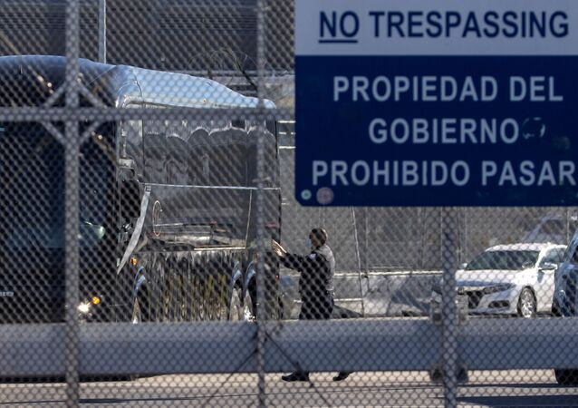 A bus leaves a closed border facility as migrants subject to a Trump-era asylum restriction program were expected to begin entry into the United States at the San Ysidro border crossing with Mexico, in San Diego, California, U.S., February 19, 2021