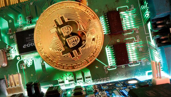 Representation of the virtual currency Bitcoin is seen on a motherboard in this picture illustration taken April 24, 2020 - Sputnik International