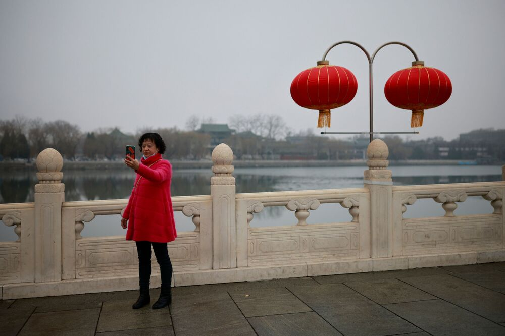 A woman takes a selfie in front of a red lantern in a park in Beijing as China celebrates Lunar New Year of the Ox following an outbreak of the coronavirus disease (COVID-19), China, 14 February 2021.