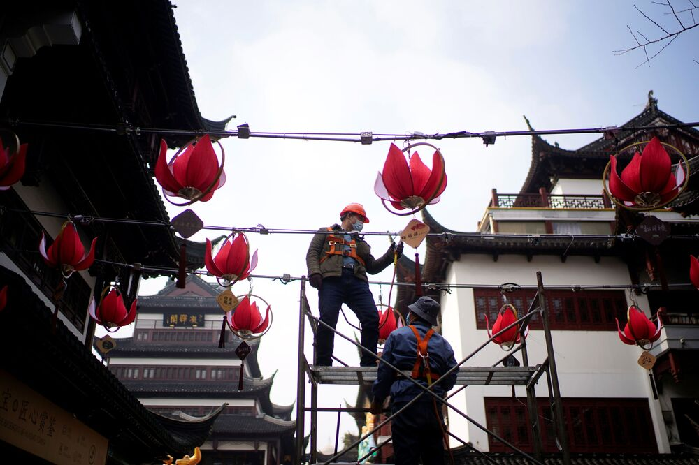 Workers install lanterns ahead of the Chinese Lunar New Year festivity at Yu Garden, following the coronavirus disease (COVID-19) outbreak in Shanghai, China 27 January  2021.