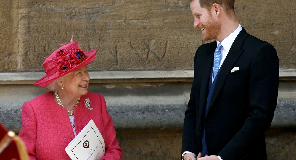 Queen Elizabeth II talks to Prince Harry as they leave after the wedding of Lady Gabriella Windsor and Thomas Kingston at St George's Chapel in Windsor Castle, near London, Britain May 18, 2019