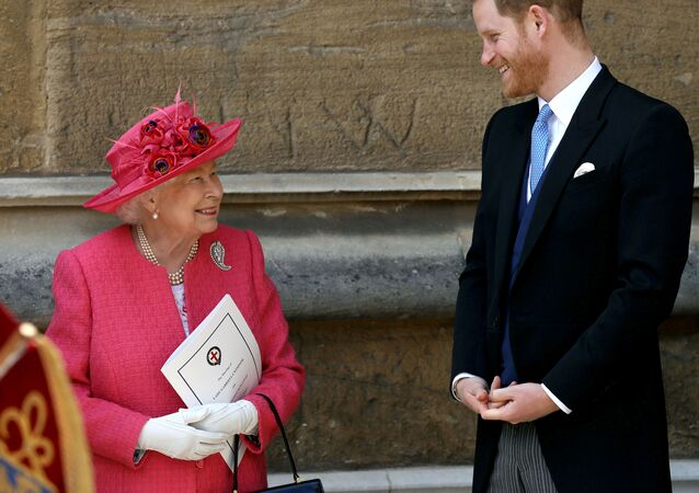 Queen Elizabeth II talks to Prince Harry as they leave the wedding of Lady Gabriella Windsor and Thomas Kingston at St George's Chapel in Windsor Castle, Berkshire, England, 18 May 2019.
